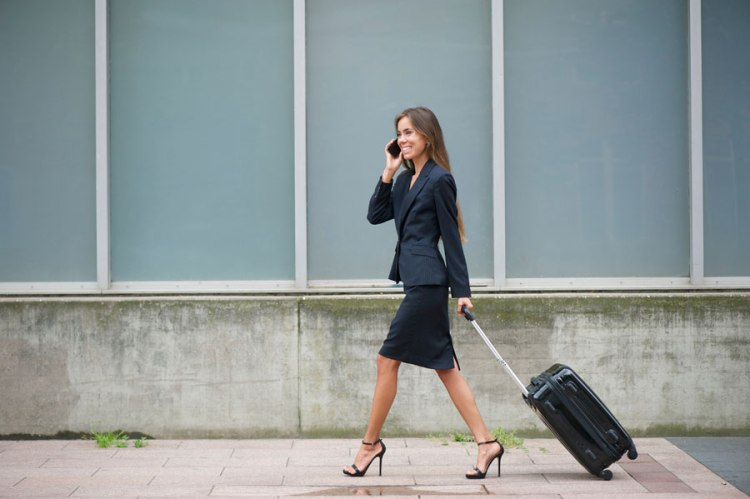 business-woman-on-phone-with-suitcase